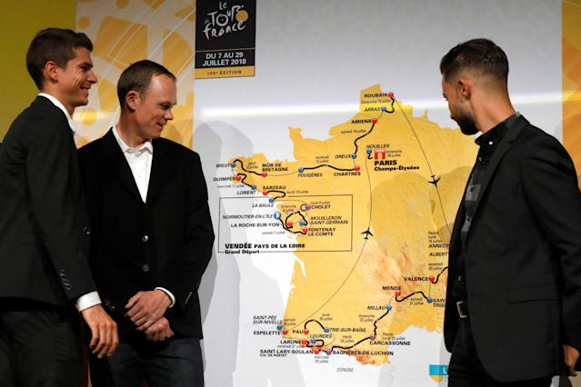Tour de France 2017 winner Chris Froome of Britain (C) and Warren Barguil (L) look at the map of the itinerary of the 2018 Tour de France cycling race during a news conference in Paris, France, October 17, 2017. The world's greatest cycling event will start from Noirmoutier-en-L'Ile on July 7 and will finish at the Champs Elysees in Paris on July 29. REUTERS/Charles Platiau