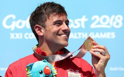 <span>Tom Daley with his gold medal in the Men's Synchronised 10m Platform Final at the 2018 Commonwealth Games</span> <span>Credit: PA </span>