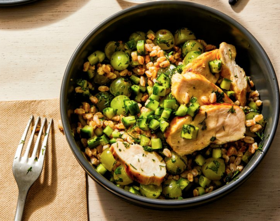 <p>If salads just don't fill you up, swap the greens for grains. They have more flavor, carry a strong dose of gut-filling fiber.</p><p>What You'll Need:<br>3 (8 oz) pouches microwavable farro, quinoa, or brown rice<br>1/2 cup bottled sesame dressing<br>1 cup halved green seedless grapes<br>1 cup small-diced seedless cucumber<br>1/4 cup chopped fresh flat-leaf parsley<br>2 Tbsp chopped fresh dill<br>1 lb grilled boneless skinless chicken breast strips</p><p>How to Make It:</p><p>In 4 storage containers, divide the grain, dressing, grapes, cucumber, parsley, and dill and toss to combine. Season to taste with salt and pepper. Top with the chicken. Can be served hot, at room temperature, or cold. Will hold in an airtight container in the refrigerator for up to a week. </p>