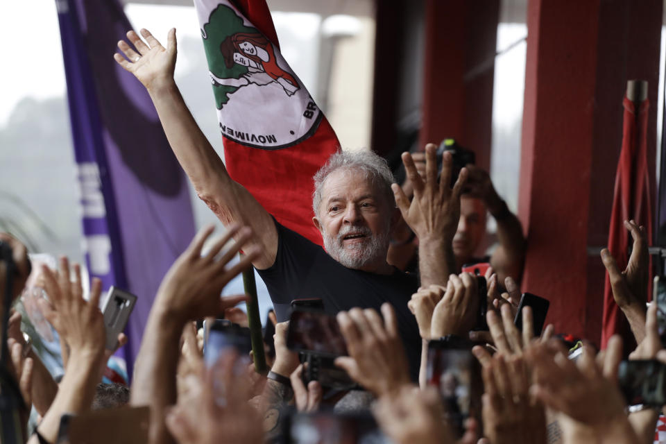 Brazil's former President Luiz Inacio Lula da Silva is carried by supporters in front of the metal workers union headquarters in Sao Bernardo do Campo, Brazil, Saturday, Nov. 9, 2019. Lula is released from prison following a Supreme Court decision late Thursday that a person can be imprisoned only after all appeals to higher courts have been exhausted. He has been detained since April 2018 after being convicted of corruption. (AP Photo/Nelson Antoine)