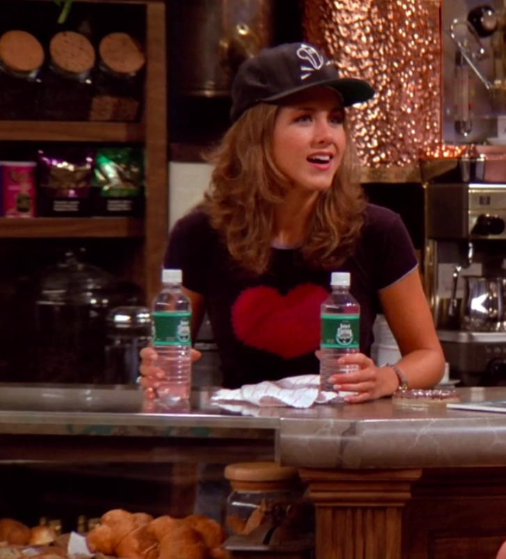 Rachel wearing sneakers, jeans, a short-sleeve crop top, and a baseball hat