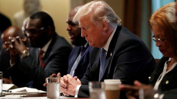 PHOTO: President Donald Trump prays during a meeting with inner city pastors at the Cabinet Room of the White House in Washington, D.C., Aug. 1, 2018. (Carlos Barria/Reuters)