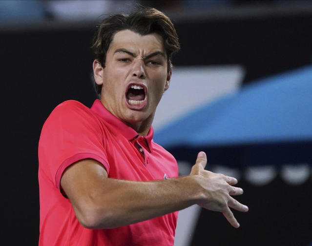 Taylor Fritz of the U.S. celebrates after defeating Kevin Anderson of South Africa in their second round singles match at the Australian Open tennis championship in Melbourne, Australia, Thursday, Jan. 23, 2020. (AP Photo/Lee Jin-man)