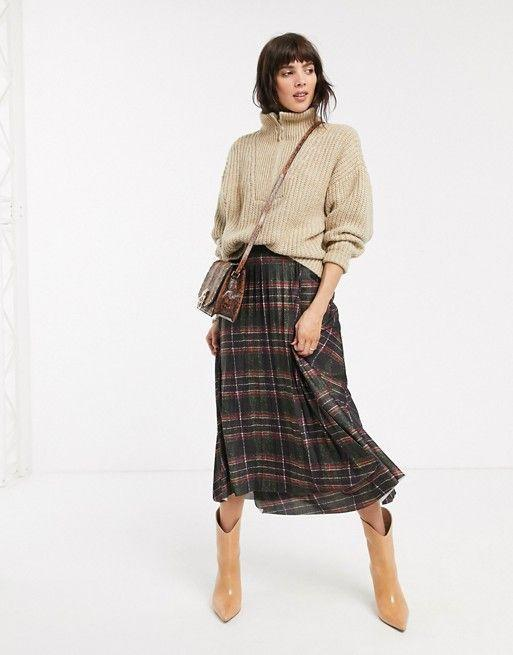 """<p><strong>Asos DESIGN</strong></p><p>us.asos.com</p><p><strong>$38.40</strong></p><p><a href=""""https://go.redirectingat.com?id=74968X1596630&url=https%3A%2F%2Fwww.asos.com%2Fus%2Fasos-design%2Fasos-design-check-pleat-midi-wrap-skirt%2Fprd%2F13558180&sref=https%3A%2F%2Fwww.cosmopolitan.com%2Fstyle-beauty%2Ffashion%2Fg32678355%2Fflannel-outfits-how-to-wear%2F"""" rel=""""nofollow noopener"""" target=""""_blank"""" data-ylk=""""slk:Shop Now"""" class=""""link rapid-noclick-resp"""">Shop Now</a></p><p>Okay, I'm actually obsessed with this outfit. The half-zip sweater, plaid skirt, snakeskin print bag, and patent leather boots mixes up so many textures and prints in the best way possible. </p>"""