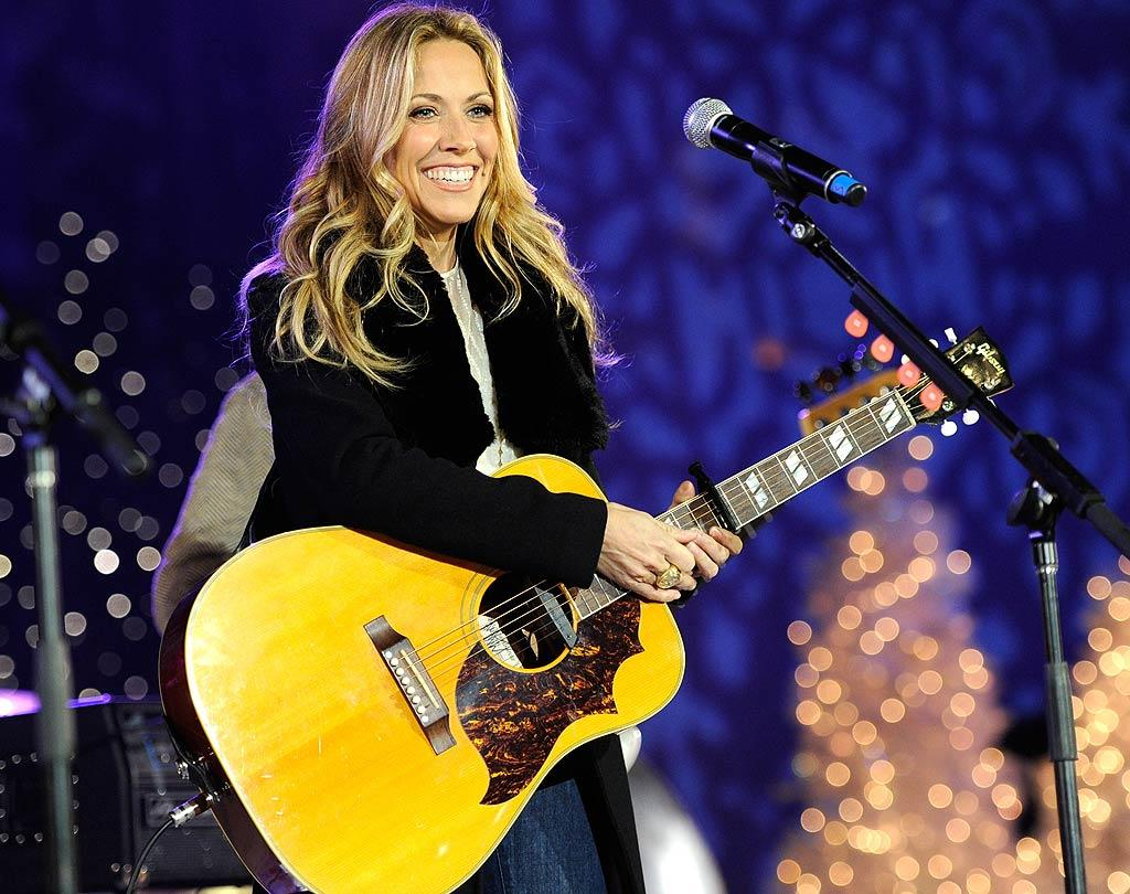 """Sheryl Crow & The Thieves wowed the crowd with a rousing version of """"Long Road Home"""" for the lighting of the tree, which this year stood at 74 feet, complete with 30,000 energy-efficient LED lights! Kevin Mazur/<a href=""""http://www.wireimage.com"""" target=""""new"""">WireImage.com</a> - November 30, 2010"""