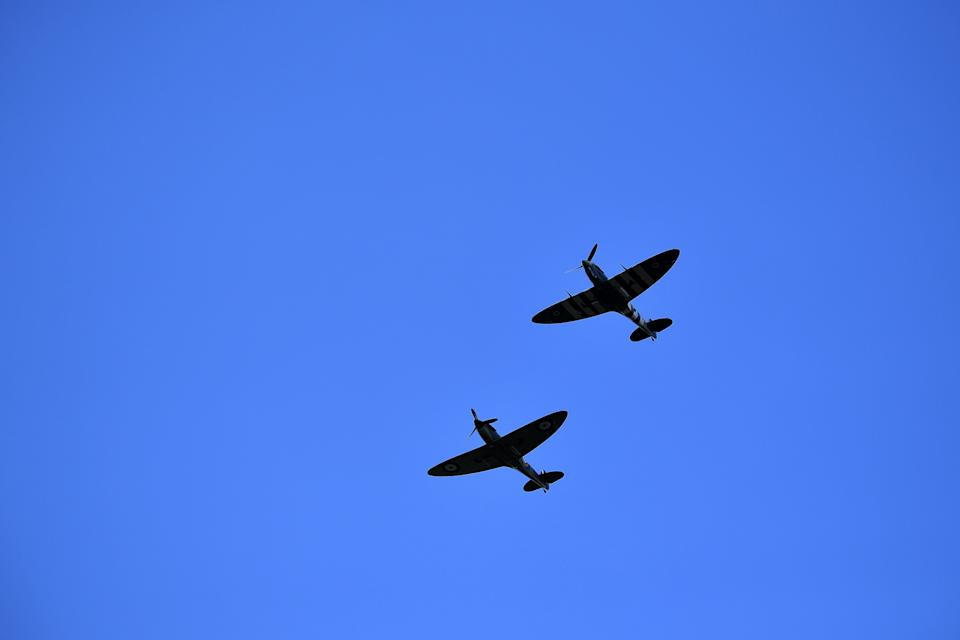 "Spitfire planes perform a fly-past above Ditchling, south of London, on July 10, 2020, during the funeral of WWII performer Vera Lynn. - People gathered on the streets of to bid a final farewell Friday, to World War II ""forces' sweetheart""  Vera Lynn, who died last month. A performer from the age of seven, Lynn also starred in films, enjoyed a number of post-war hits and was made a Dame of the British Empire in 1976. (Photo by Ben STANSALL / AFP) (Photo by BEN STANSALL/AFP via Getty Images)"