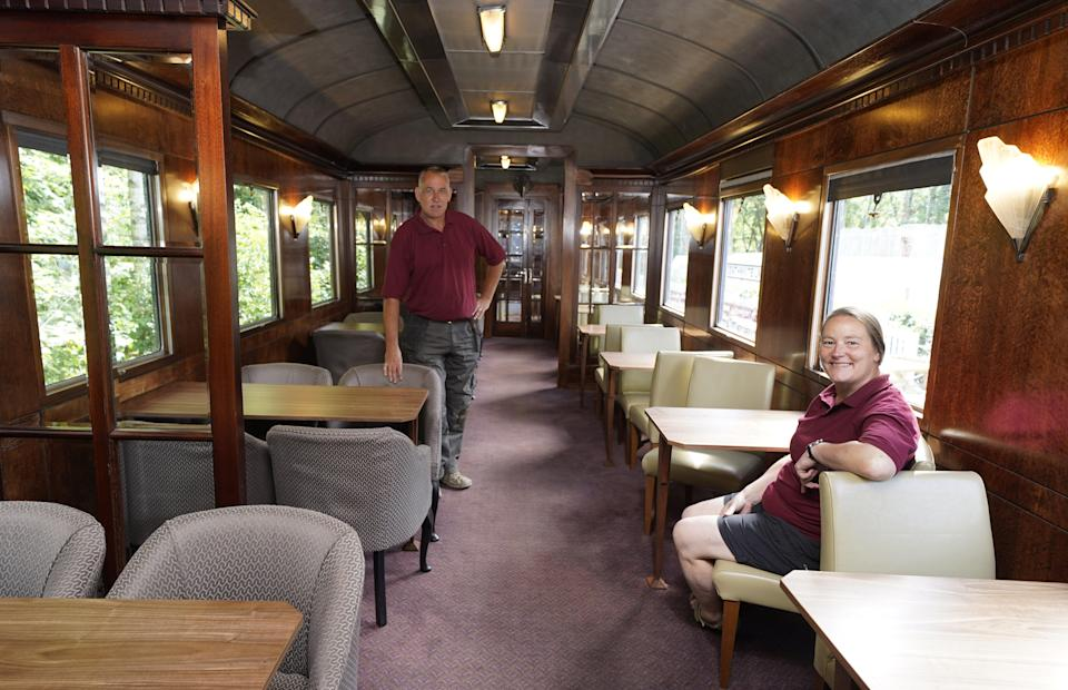 Simon and Diana Parums inside their full-size steam train in Keswick (Owen Humphreys/PA) (PA Wire)