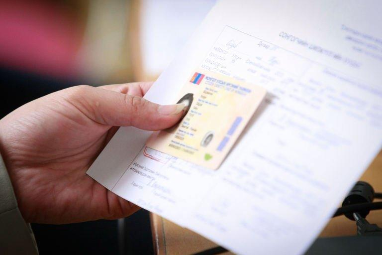 A Mongolian voter holds a ballot at a polling station in Ulan Bator, on June 26, 2013