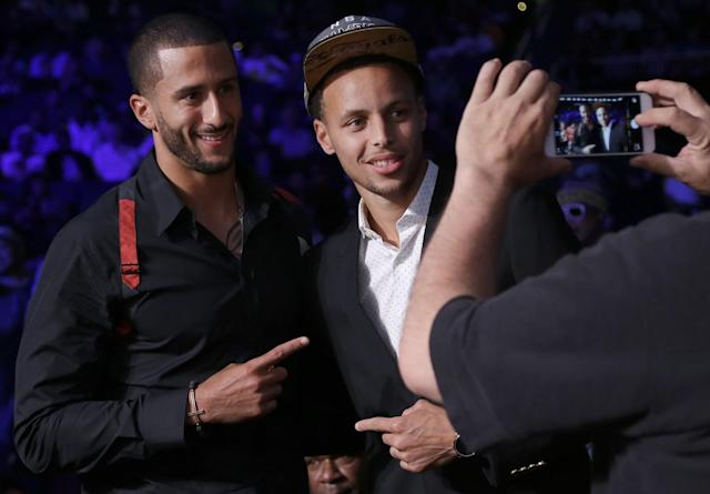 San Francisco 49ers quarterback Colin Kaepernick (left) poses for photos with Golden State Warriors guard Stephen Curry at the boxing match boxing between Andre Ward against Paul Smith in Oakland, Calif., on Saturday, June 20, 2015. (AP/Jeff Chiu)