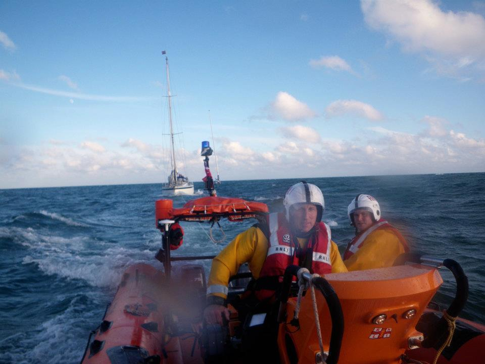Andy Harris at the helm of the Blue Peter 1 towing a yacht back to harbour in June 2012 (RNLI/PA)