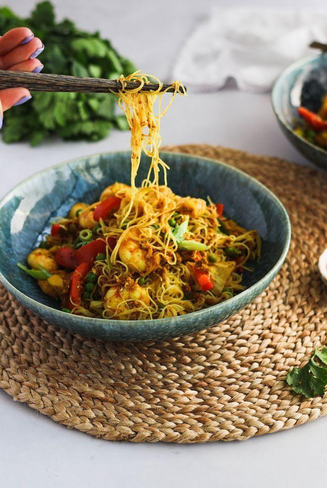 """<p>Singapore noodles is a Chinese takeaway classic. Complete with king prawns, shiitake mushrooms and frozen peas, this super-simple <a href=""""https://www.delish.com/uk/cooking/recipes/a30607809/chicken-broth/"""" rel=""""nofollow noopener"""" target=""""_blank"""" data-ylk=""""slk:noodle"""" class=""""link rapid-noclick-resp"""">noodle</a> recipe comes together in a matter of minutes!</p><p>Get the <a href=""""https://www.delish.com/uk/cooking/recipes/a36227169/singapore-noodles/"""" rel=""""nofollow noopener"""" target=""""_blank"""" data-ylk=""""slk:Singapore Noodles"""" class=""""link rapid-noclick-resp"""">Singapore Noodles</a> recipe.</p>"""