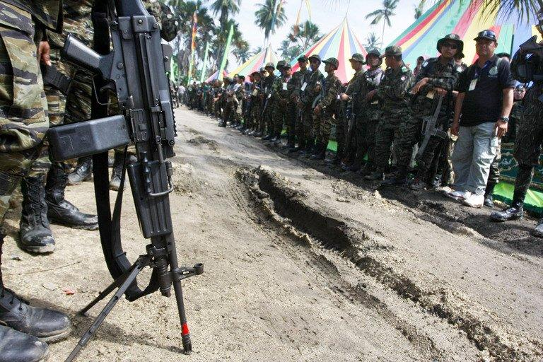Moro Islamic Liberation Front (MILF) personnel line on a road in Camp Darapanan on July 7, 2012