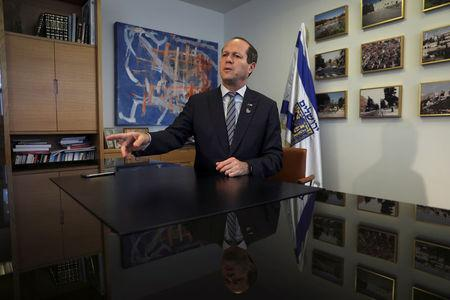 Nir Barkat, the mayor of Jerusalem, speaks during his interview with Reuters in his office at the Jerusalem Municipality April 24, 2017. Picture taken April 24, 2017. REUTERS/Ronen Zvulun