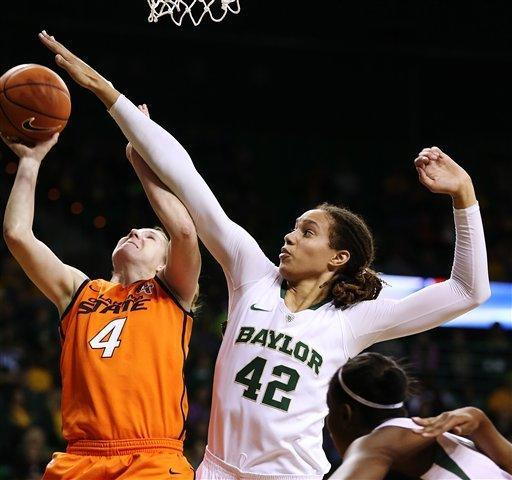 Baylor's Brittney Griner (42) pressures Oklahoma State's Liz Donahoe (4) during the first half of their NCAA college basketball game, Sunday, Jan. 6, 2013, in Waco, Texas. (AP Photo/The Waco Tribune-Herald, Rod Aydelotte)