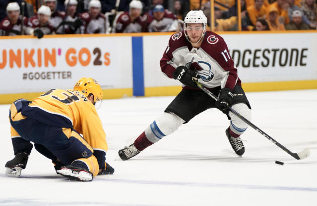Colorado Avalanche center Tyson Jost (17) makes a move around Nashville Predators left wing Viktor Arvidsson (33), of Sweden, during the first period in Game 5 of an NHL hockey first-round playoff series Friday, April 20, 2018, in Nashville, Tenn. (AP Photo/Sanford Myers)