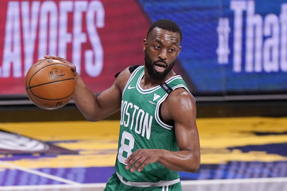 Boston Celtics guard Kemba Walker (8) looks for his next move during the first quarter of Game 2 of an NBA basketball first-round playoff series against the Brooklyn Nets, Tuesday, May 25, 2021, in New York. (AP Photo/Kathy Willens)