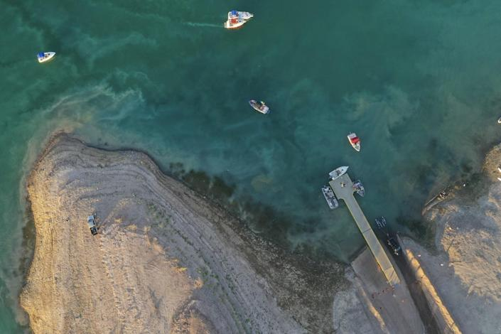 An aerial view of a boat launch ramp on the lake