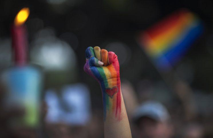 A defiant fist is raised at a vigil in Los Angeles on June 13. (Photo: David McNew/Getty Images)
