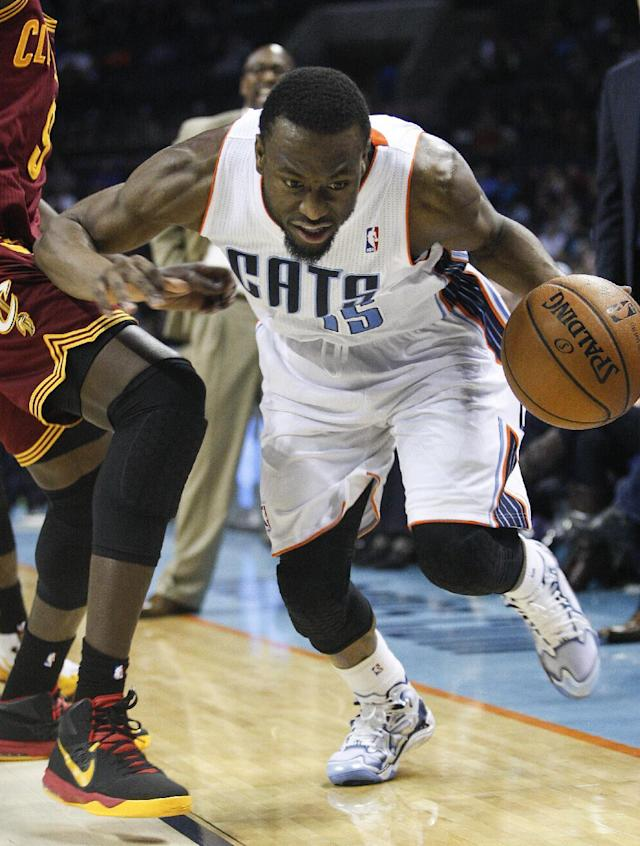 Charlotte Bobcats guard Kemba Walker drives against the Cleveland Cavaliers during the second half of an NBA basketball game in Charlotte, N.C., Friday, March 7, 2014. Charlotte won 101-92. (AP Photo/Nell Redmond)