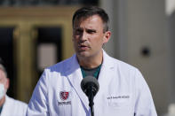 Dr. Sean Dooley, talks with reporters at Walter Reed National Military Medical Center, Monday, Oct. 5, 2020, in Bethesda, Md. (AP Photo/Evan Vucci)