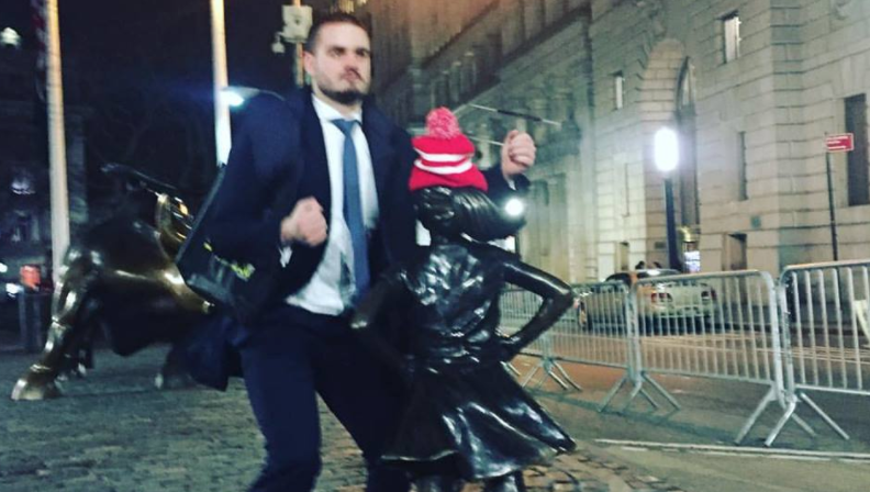 Intimidated by Feminism, Wall Street Bro Humps 'Fearless Girl'