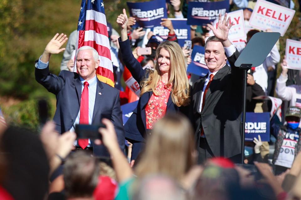Vice President Mike Pence (from left) and Sens. Kelly Loeffler and David Perdue wave to supporters at a Defend the Majority Rally in Canton, Georgia, Friday. (Photo: Jason Armond via Getty Images)