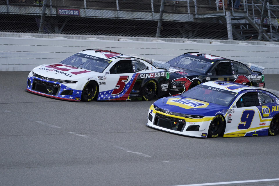 Kyle Larson (5), Matt DiBenedetto (21) and Chase Elliott (9) lead the field to start the NASCAR Cup Series auto race at Michigan International Speedway, Sunday, Aug. 22, 2021, in Brooklyn, Mich. (AP Photo/Carlos Osorio)