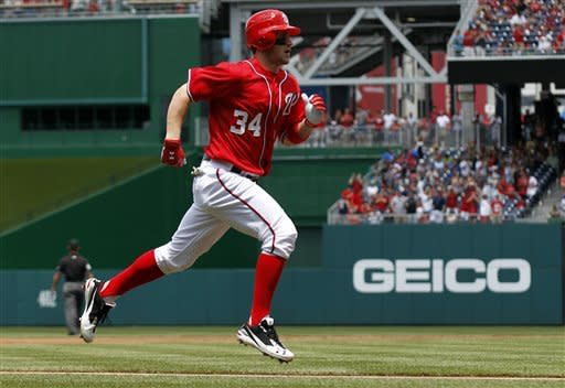 Washington Nationals' Bryce Harper rounds the bases after his solo home run during the first inning of a baseball game with the Atlanta Braves, Sunday, June 3, 2012, in Washington. (AP Photo/Alex Brandon)