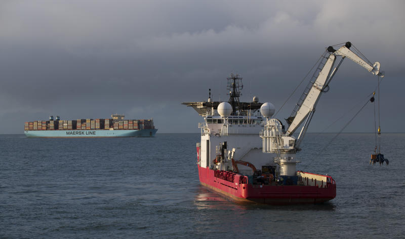 In this Monday, Jan. 21, 2019, file image, The Geosund salvaging ship lifts a container from the seabed off the northwestern coast of the Netherlands. Dutch authorities say a freight ship lost dozens more containers than previously thought when it was caught in a heavy storm early this year. The Dutch water authority said Wednesday Feb. 6, 2019, that at least 345 containers fell off the MSC Zoe freighter Jan. 2. The previous estimate was 291. (AP Photo/Peter Dejong)