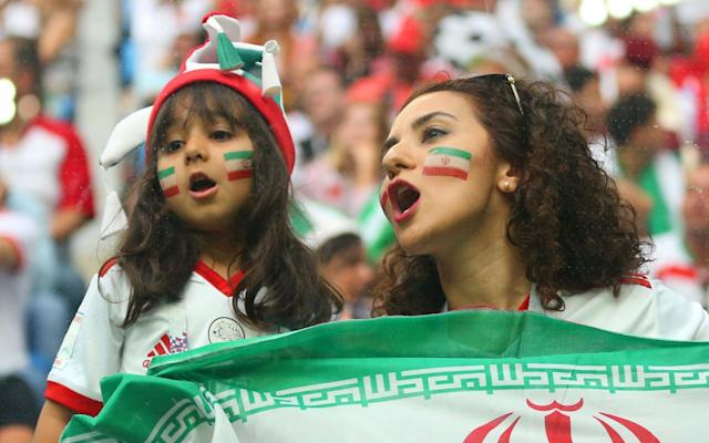 "For Kiana and Paria, two twentysomething women from Iran, this World Cup has been a liberating experience. For a start, the two of them have been able to do something they never have been able to do in their own country: go to a football match. In fact, earlier this year, when Paria tried to attend a game in her home city she was arrested. The charge was offending public decency. ""I love sport, I love football and in Iran women can't go to watch,"" she explains. ""One night I try. I go to the game and I went to jail."" It happened in March. A rumour was circulating that the Iranian government had relaxed the strict rules preventing women from showing their enthusiasm for the sport. ""We had heard it was OK,"" says Paria. ""We thought they were allowing us."" So she and her boyfriend headed off to see the Tehran derby between Persepolis and Esteghlal. But it was not OK, things had not changed. Along with 29 other women who had mistakenly smelled a whiff of liberalisation in the wind, the moment she tried to go through the turnstiles, Paria was arrested and taken to the police station. Her crime? Being a woman in an all-male environment. ""I was only in the prison one night,"" she says. ""The police were polite to me."" But what annoyed her most was this: she missed the match. Thus when Iran qualified for Russia 2018 last November, the two women, together with Kiana's boyfriend Pedro, immediately bought tickets for all of their country's group stage games. The World Cup has given Iran fans Paria (right) and Kiana the opportunity to attend their first football match without the risk of arrest And last week they found themselves in Saint Petersburg for the 1-0 victory over Morocco that put Iran top of Group B, ahead of Spain and Portugal. For this pair it was not just the result that made it a momentous event: this was the first time they had been allowed to attend a game live. ""I have been watching football on television at home since I was a kid,"" says Kiana. ""I have no brother around so my father he makes me watch football. That's why I became fan."" And never mind that she had to travel 1,900 miles to do so, the experience of attending a match turned out to be everything she had hoped. ""From the moment I walked in and see the crowd and the noise and see our players, I feel so proud,"" she says. ""I was thinking what's the reason to not let the women into the stadium? What's the point? We are like you guys, I was supporting the team like a man."" And she breaks into a chant: ""Hamle, hamle, Iran hamle [Move, move, Iran move],"" putting on a deep, gruff voice. ""My voice is as strong as a man,"" she laughs. Kiana and Paria are by no means alone. It is one of the ironies of this World Cup that the nation which precludes its women from watching matches has the highest proportion of female fans here in Russia. Kazan is full of female Iran supporters. They have come in their droves, not just from Tehran, but from the expatriate communities in Australia, the United States and Germany. Banners were held up during Iran's first tie denouncing the ban on women attending football matches in Iran Credit: Getty Images ""Of 30,000 Iran fans here,"" says Paria, ""10,000 are women."" And, while they are in Russia, the pair are not just relishing the chance to watch the football. Ahead of Iran's game with Spain, they are out exploring the old parts of the city of Kazan wearing the sort of attire that would have them locked up again in Tehran. ""We are not allowed to wear clothes like this outside, but in our homes, yes, we wear this,"" says Kiana of her denim shorts and football shirt. ""We do not have to wear hijab yet, but we have to have our hair covered with scarf."" And choice of clothing is at the heart of the new form of protest in Tehran, in which the two regularly engage. ""White Wednesday, have you heard of that?"" says Kiana. ""We support Masih Alinejad [the founder of a social media group My Stealthy Freedom]. On Wednesday we all wear the white, men too who support us against compulsory hijab. Some women take off the headscarf, we haven't yet. We are not quite brave enough."" Russia World Cup in pictures: Best photos of teams, games and players Their choice of World Cup clothing means that, while in Kazan, the two of them are unable to visit the magnificent old mosque, which is just behind where they are standing, flourishing their Iran flags. A picture on a sign at its entrance stops women from entering in anything other than the most modest of attire. Not that they seem to mind. ""Come on,"" smiles Kiana. ""We have lots of mosques in Iran. We don't need to go and see another one."" These, then, are football revolutionaries, their attendance at the World Cup an opportunity to expose the restrictions of life back home. ""Football is helping a lot to change things,"" says Pedro, Kiana's boyfriend. ""But it cannot do it alone. Other things have to happen. Political issues. Right now it is a tense moment in Iran. We are hoping for regime change. We cross our fingers."" That is if they have any fingers left to cross, what with wishing for all the luck they can get ahead of Wednesday's game with Spain. ""We hope we are going to make history. We are believers,"" says Kiana. ""All of the players are my favourite. All of them, even our coach is the best coach ever. We are so proud of them."" And frankly they should be proud of her. World Cup 2018 