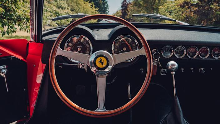 The vehicle's interior features a wood-rimmed steering wheel, a dashboard with Veglia dials, and a ball-topped shifter rising from the transmission tunnel. - Credit: Photo: Courtesy of GTO Engineering.
