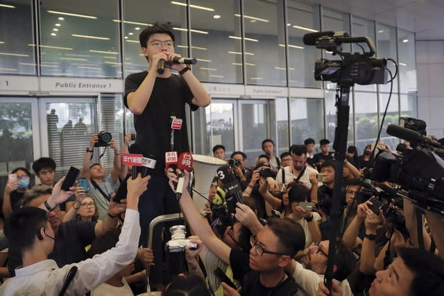 Pro-democracy activist Joshua Wong speaks to protesters near the Legislative Council in Hong Kong