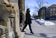 Canadian Prime Minister Justin Trudeau makes his way to hold a press conference in Ottawa, Ontario, Friday, March 5, 2021. (Sean Kilpatrick/The Canadian Press via AP)