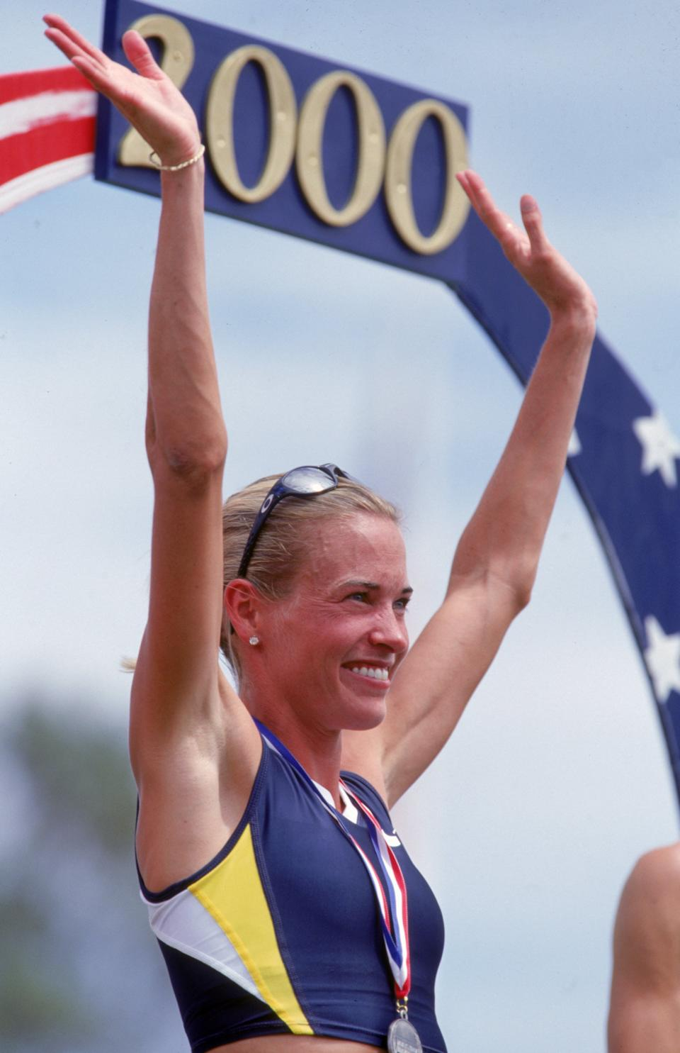 16 Jul 2000: Suzy Favor Hamilton of the USA celebrates on the winners podium after the Women's 1,500 meter event of the 2000 U.S. Olympic Track & Field Team Trials at the Hornet Stadium in Sacramento, California.Mandatory Credit: Andy Lyons /Allsport