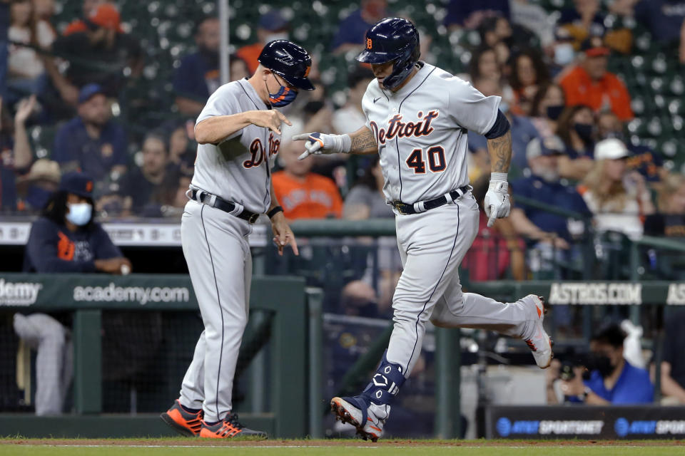 Detroit Tigers third base coach Chip Hale, left, celebrates with Wilson Ramos (40), who had hit a two-run home run against the Houston Astros during the fifth inning of a baseball game Tuesday, April 13, 2021, in Houston. (AP Photo/Michael Wyke)