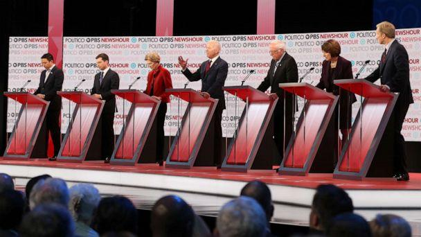 PHOTO: Democratic presidential candidates listen during the Democratic presidential primary debate at Loyola Marymount University on December 19, 2019 in Los Angeles, California. (Justin Sullivan/Getty Images)