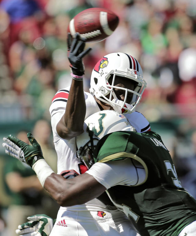 Louisville quarterback Teddy Bridgewater (5) is hit by South Florida linebacker Devekeyan Lattimore (34) while throwin a pass in the first quarter of an NCAA college football game Saturday, Oct. 26, 2013, in Tampa, Fla. (AP Photo/Chris O'Meara)