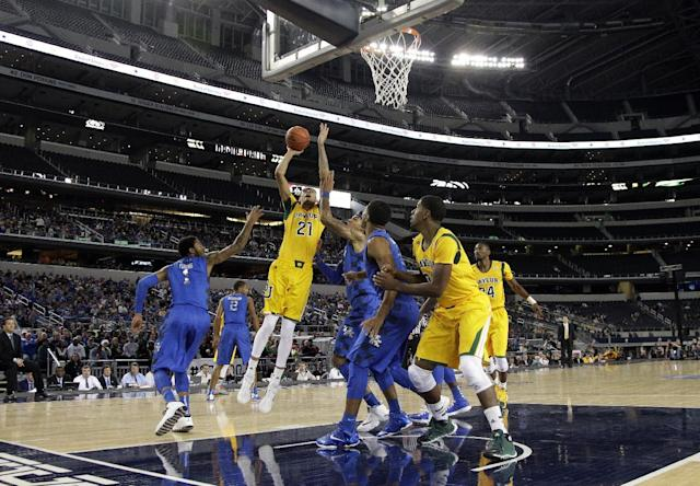 Baylor center Isaiah Austin (21) goes up for a shot as Kentucky's James Young (1) defends in the first half of an NCAA college basketball game at AT&T stadium, Friday, Dec. 6, 2013, in Arlington, Texas. (AP Photo/Tony Gutierrez)