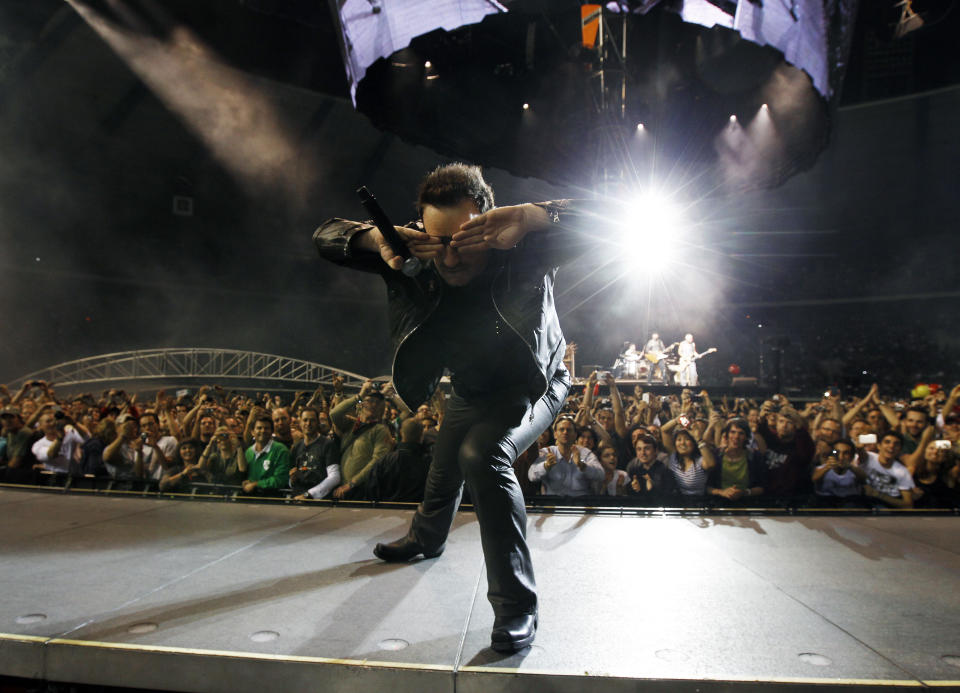 Lead singer Bono of Irish rock band U2 performs during their 360 Degree Tour at King Baudouin Stadium in Brussels September 22, 2010.   REUTERS/Thierry Roge   (BELGIUM - Tags: ENTERTAINMENT)