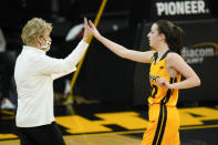 Iowa guard Caitlin Clark, right, celebrates with coach Lisa Bluder during the first half of the team's NCAA college basketball game against Ohio State, Wednesday, Jan. 13, 2021, in Iowa City, Iowa. Clark is fourth in the nation in scoring, fourth in the nation in assists and ninth in assists per game. She is also second on the team in rebounds and tied for the team lead in blocked shots. Shes not one-dimensional, Bluder said. (AP Photo/Charlie Neibergall)