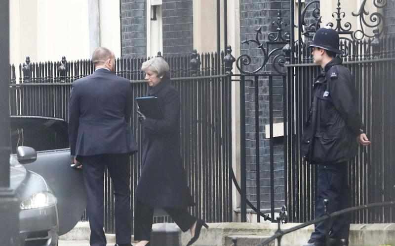 Theresa May leaving Downing Street on Thursday morning - Credit: NEIL HALL/Reuters