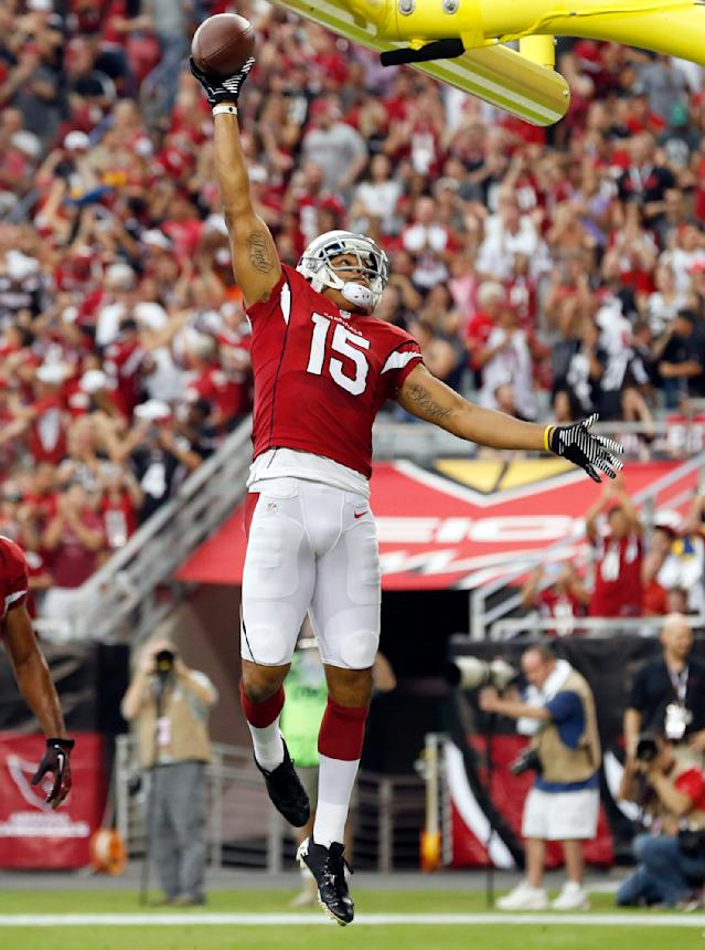 Arizona Cardinals wide receiver Michael Floyd celebrates his touchdown against the Atlanta Falcons during the first half of an NFL football game Sunday, Oct. 27, 2013, in Glendale, Ariz. (AP Photo/Ross D. Franklin)