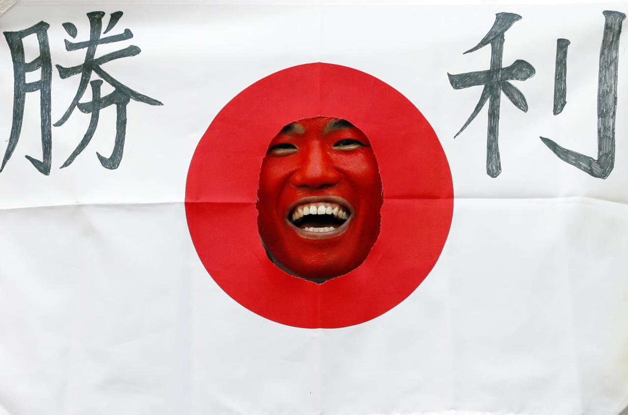<p>A Japan fan laughs before the Russia 2018 World Cup Group H football match between Colombia and Japan at the Mordovia Arena in Saransk. (Jack GUEZ / AFP) </p>