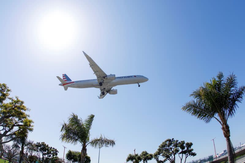 An American Airlines passenger jet approaches to land at LAX in Los Angeles