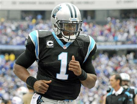 Panthers' Newton jogs off the field after being defeated by the Bills in their NFL football game in Orchard Park