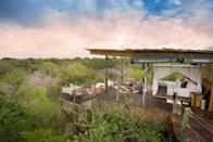 """Set on the banks of the Sabi River, this luxurious resort on 10,000 acres comprises four lodges and two villas. Ivory Lodge rooms, done in ebony and ivory, have African artifacts and views of the reserve and its occupants from private terraces with plunge pools, while the cream and beige rooms at River Lodge have freestanding tubs as well as indoor and outdoor showers. Three unique treehouses, Chalkley, Kingston, and Tinyeleti, couldn't be more romantic, lit by lanterns, candles, the stars and the moon. After <a href=""""https://www.cntraveler.com/story/the-complete-guide-to-safari?mbid=synd_yahoo_rss"""" rel=""""nofollow noopener"""" target=""""_blank"""" data-ylk=""""slk:viewing elephants and lions on open jeep drives"""" class=""""link rapid-noclick-resp"""">viewing elephants and lions on open jeep drives</a>, enjoy traditional Boma dining, then settle in for the night, surrounded by the distant sounds of hippos, hyenas, leopards, and lions."""