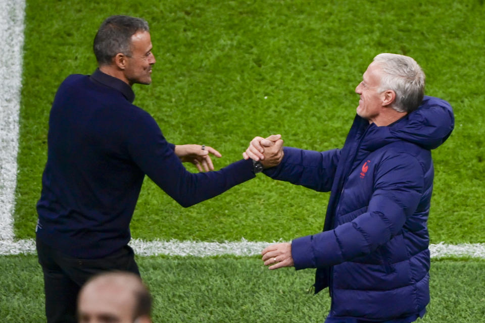 Rival coaches Spain's manager Luis Enrique, left, and France's manager Didier Deschamps shake stands ahead of the UEFA Nations League final soccer match between Spain and France at the San Siro stadium, in Milan, Italy, Sunday, Oct. 10, 2021. (Miguel Medina/Pool Photo via AP)