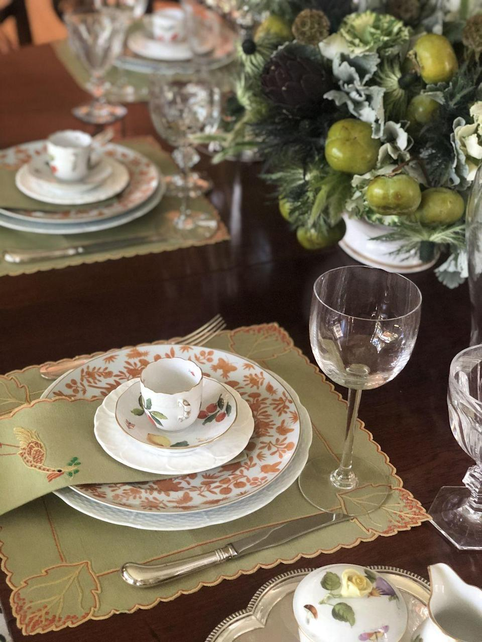 """<p>""""I am passionate about collecting linens, so I typically start there and then layer in pretty china, glassware, and silver, always mixing heirloom pieces with new-found objects,"""" says <a href=""""https://cathy-kincaid.com"""" rel=""""nofollow noopener"""" target=""""_blank"""" data-ylk=""""slk:Cathy Kincaid"""" class=""""link rapid-noclick-resp"""">Cathy Kincaid</a>, the Dallas-based interior designer known for her tailored <a href=""""https://www.veranda.com/home-decorators/a32166027/cathy-kincaid-connecticut-house-tour/"""" rel=""""nofollow noopener"""" target=""""_blank"""" data-ylk=""""slk:interiors"""" class=""""link rapid-noclick-resp"""">interiors</a>. """"Many of my linens are vintage, and I especially love <a href=""""https://dporthaultparis.com"""" rel=""""nofollow noopener"""" target=""""_blank"""" data-ylk=""""slk:D. Porthault"""" class=""""link rapid-noclick-resp"""">D. Porthault</a>, which are mostly designed to mix with one another. <a href=""""https://leontinelinens.com"""" rel=""""nofollow noopener"""" target=""""_blank"""" data-ylk=""""slk:Leontine Linens"""" class=""""link rapid-noclick-resp"""">Leontine Linens</a> are [another] favorite that I've been collecting for years.""""</p><p>Here, Kincaid mixes <a href=""""https://www.mottahedeh.com/sacred-bird-butterfly-5-piece-place-setting.html"""" rel=""""nofollow noopener"""" target=""""_blank"""" data-ylk=""""slk:Mottahedeh's Sacred Bird pattern"""" class=""""link rapid-noclick-resp"""">Mottahedeh's Sacred Bird pattern</a> with hand-painted Herring teacups (for the soup course!) and vintage Edgewood cabbageware for a multidimensional look. Clean lines on the stemware play nicely with the more detailed placemats and napkins by <a href=""""https://juliab.com"""" rel=""""nofollow noopener"""" target=""""_blank"""" data-ylk=""""slk:Julia B"""" class=""""link rapid-noclick-resp"""">Julia B</a>. The final touches that Kincaid swears by? """"For Thanksgiving, I would only use flowers and vegetables that would be bountiful at that special time of year,"""" she says. """"On this table, we placed heirloom silver candlesticks inside glass hurricane lamps, which is something I love doing.""""</p>"""