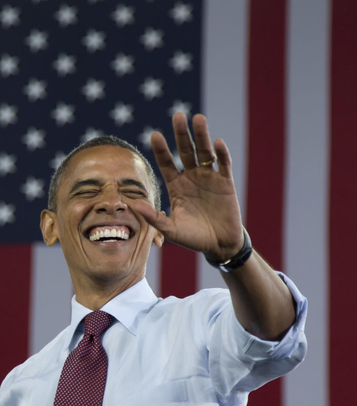 President Barack Obama waves to the crowd as he arrives at a campaign event at the Summerfest Grounds at Henry Maier Festival Park, Saturday, Sept. 22, 2012, in Milwaukee. (AP Photo/Carolyn Kaster)