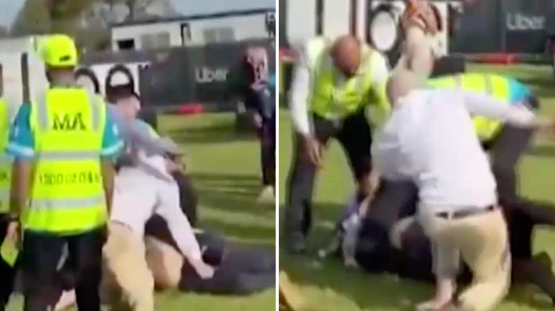 A brawl broke out at the Melbourne cup with security in yellow vests trying to break it up. (Image: Social Media)